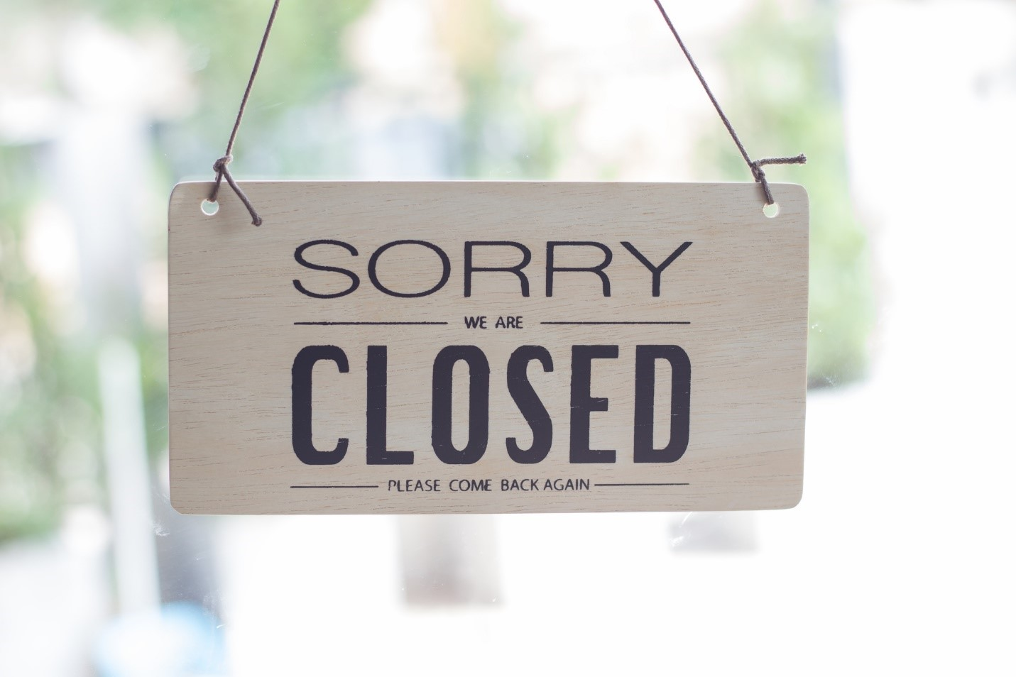 """""""Sorry, we are closed"""" sign indicating website downtime"""